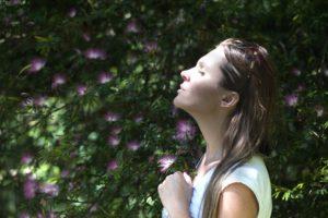 Woman outdoors breathing fresh air